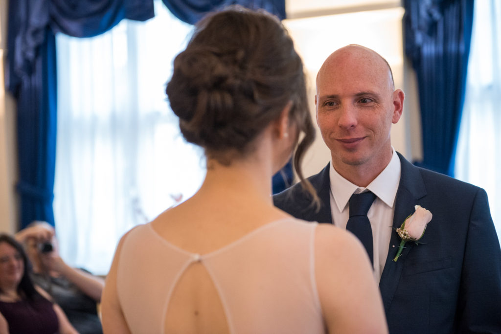 groom looking and bride