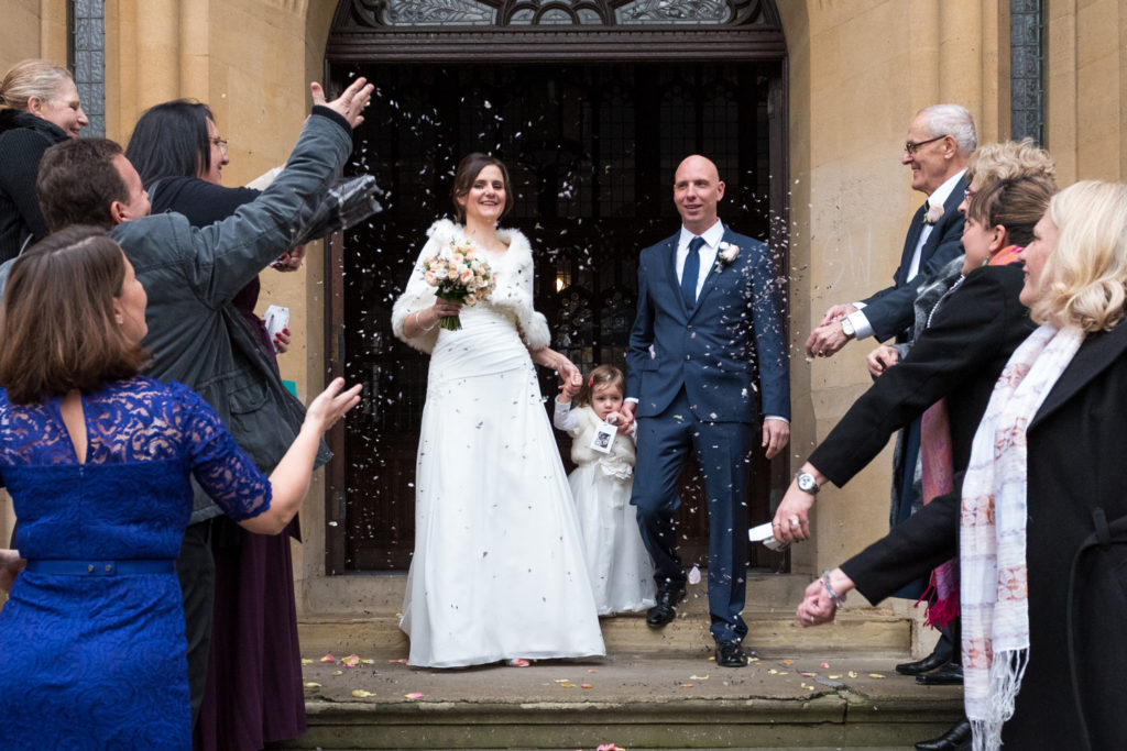 bride and groom on stairs outside