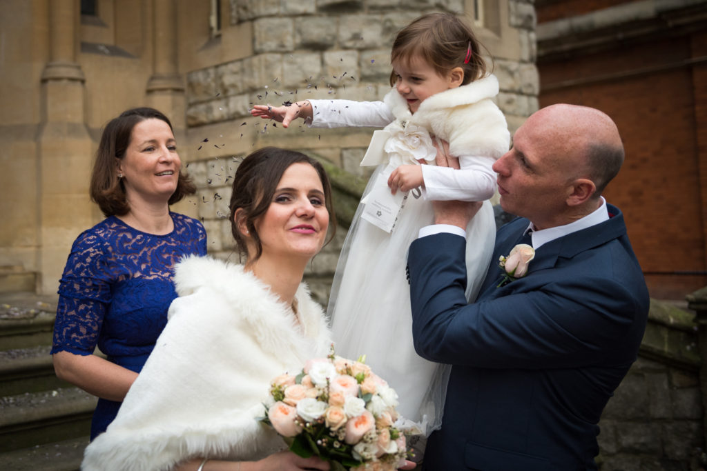 daughter thrown confetti on bride