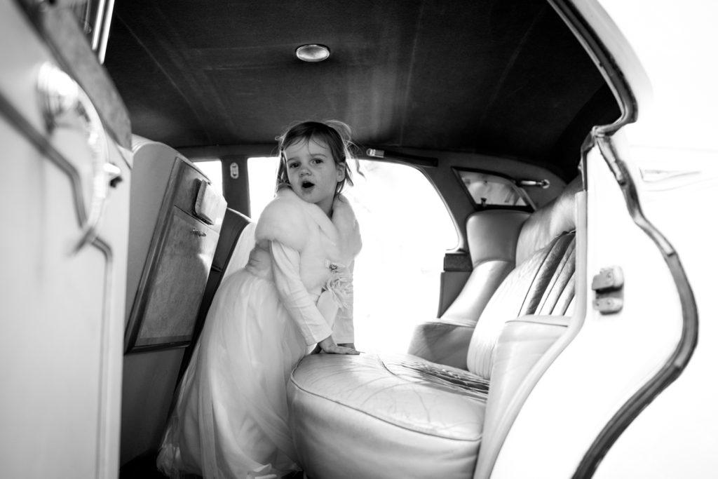 daughter climbs into car