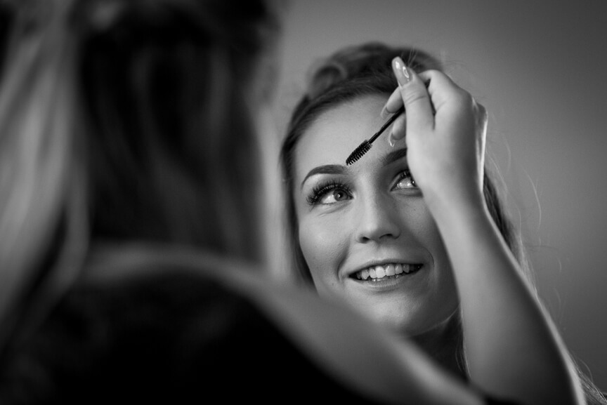 Bride gets makeup done at Holmbush House