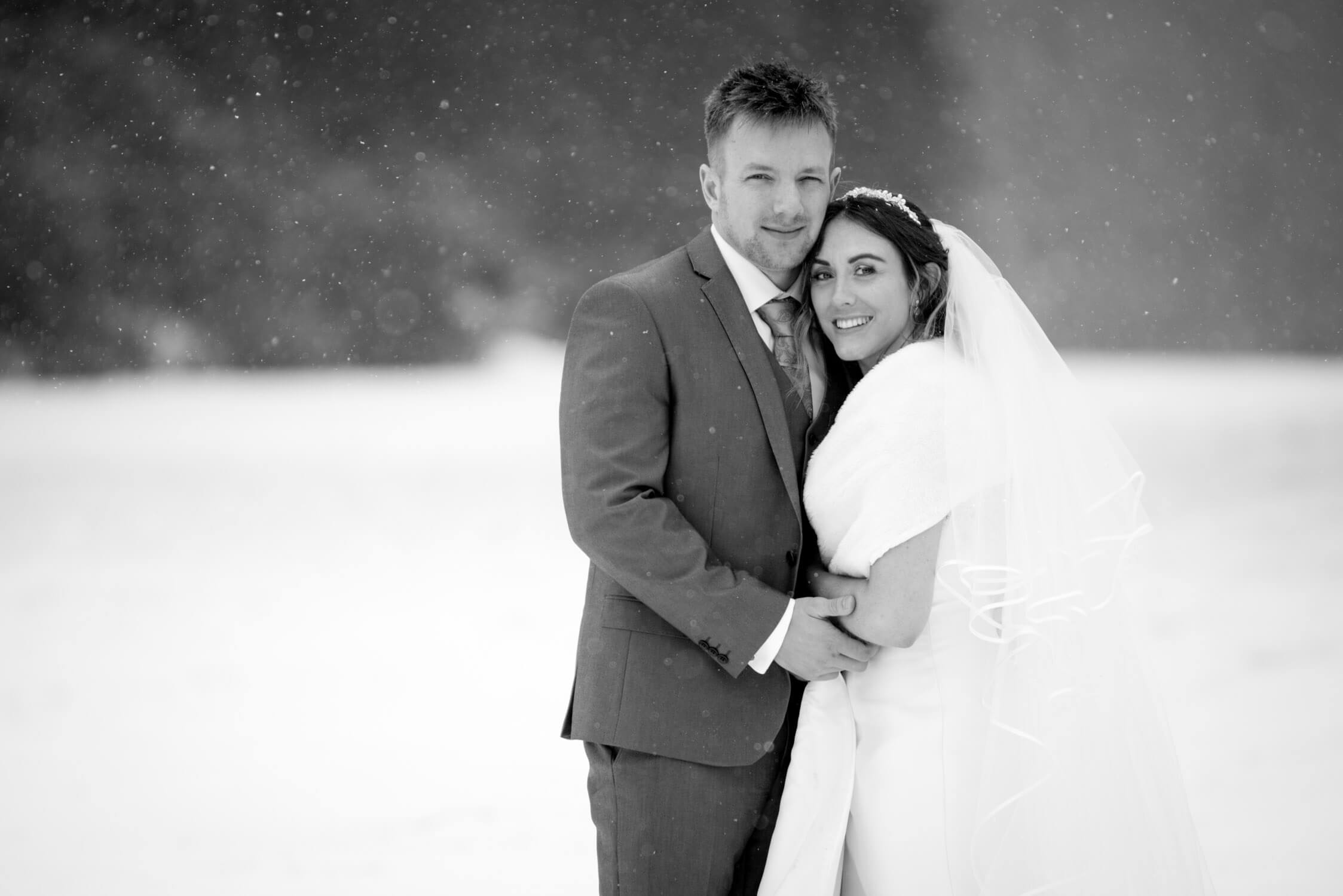 Bride and Groom in the snow at Tylney Hall