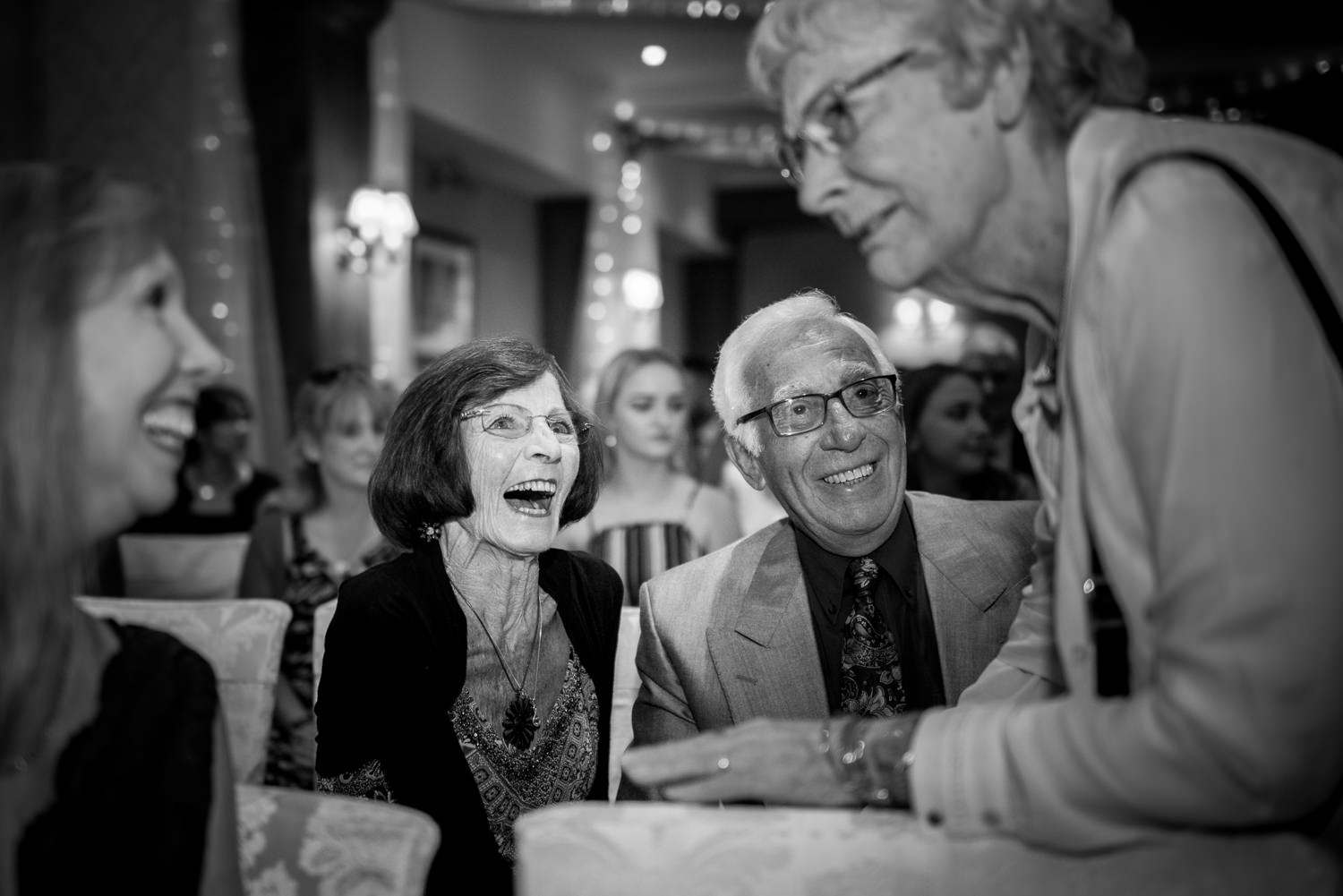 Guests at Ashdown Park Hotel share a joke before the wedding