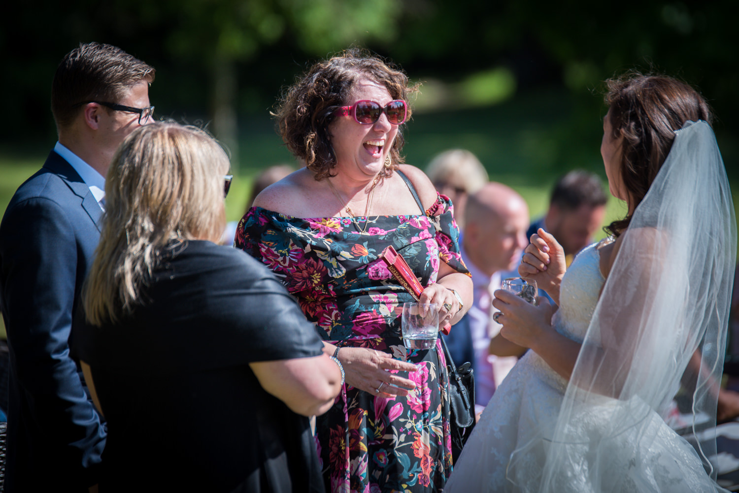 Sunshine, giggles and Pims for the guests at Ashdown Park Hotel wedding