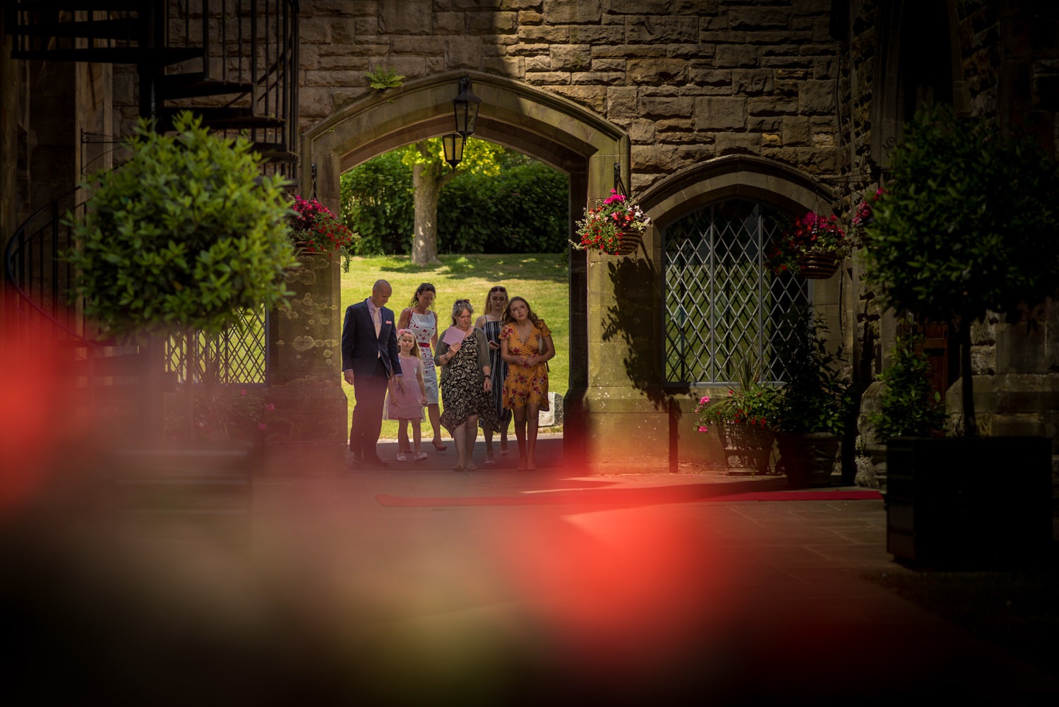 Guests arrive at Ashdown Park Hotel for the wedding ceremony